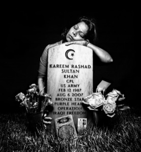 Gravestone of Iraq war hero Kareem Rashad Sultan Khan in Arlington National Cemetery, with his grieving mother.