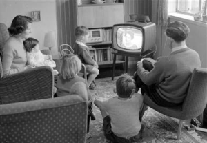 Family from the 50's in front of their TV.