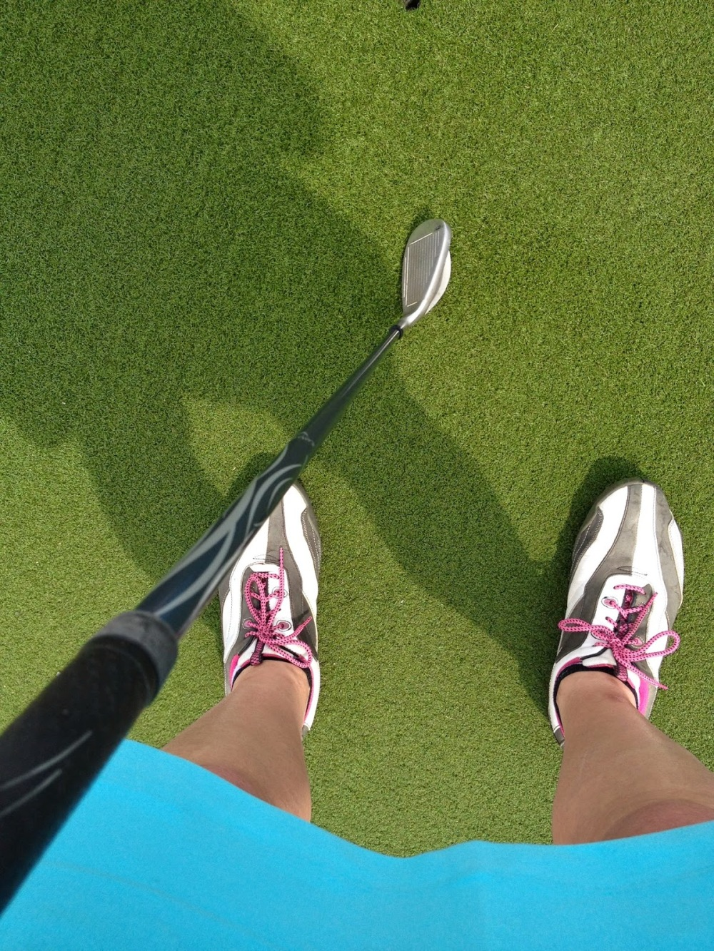 ugly golf shoes, crazy shadow and 9 iron