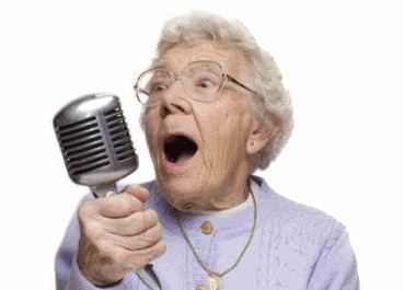 Old lady singing into a large microphone
