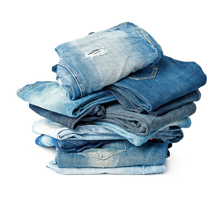 A huge pile of like nine pairs of jeans.