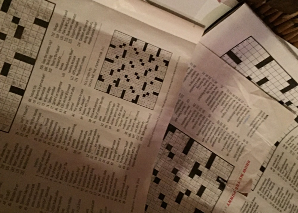 Pile of old crosswords in the Sunday Magazine appropriately piled in the recycling basket.