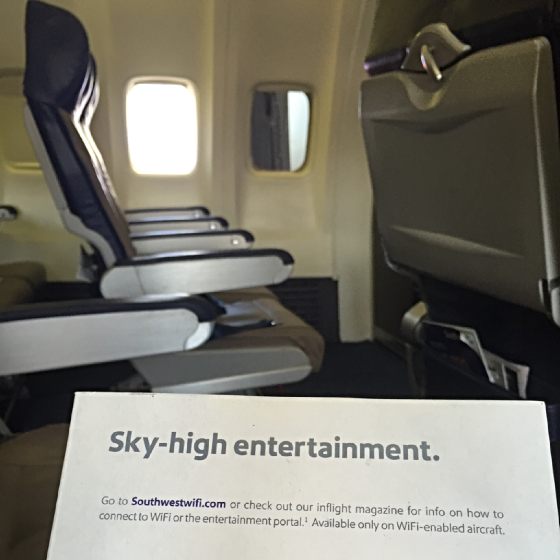 seats on a plane with entertainment guide