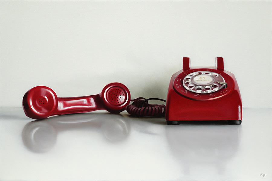 old fashioned rotary phone with the reciever off the hook.