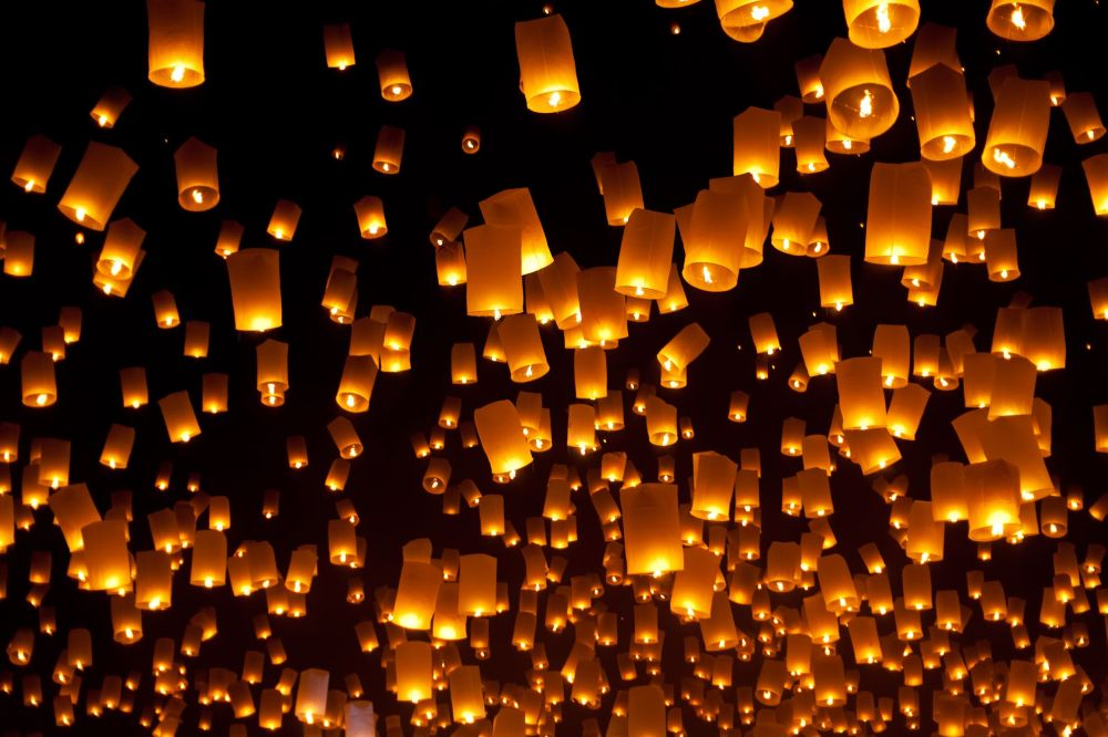 paper lanterns floating away.