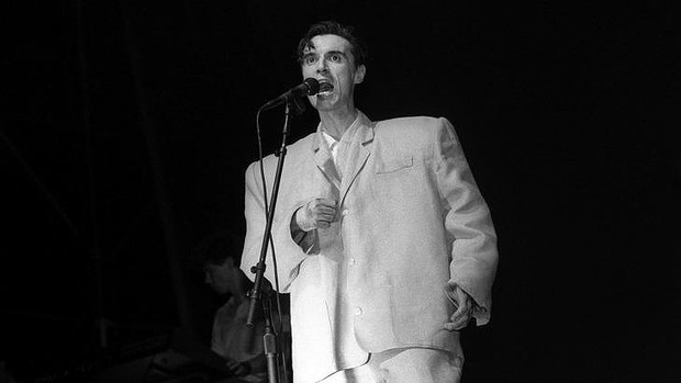 David Byrne from Talking Heads in a very ill-fitting and white suit.
