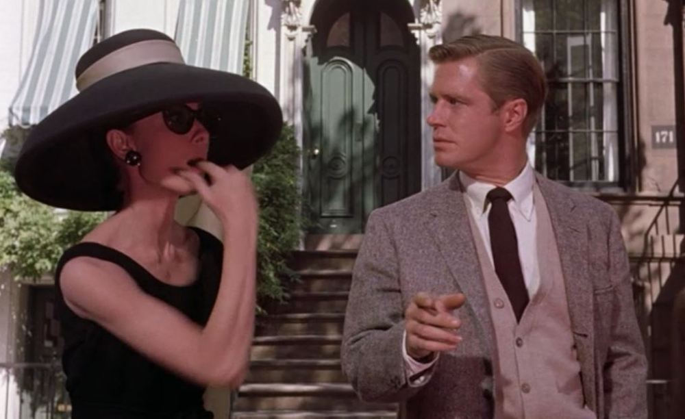 Holly Golightly whistling for a cab. She surprised what's his name.