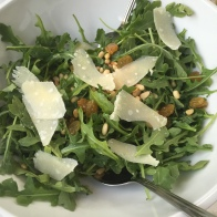 arugula pine nuts golden raisins with shaved Parmesan