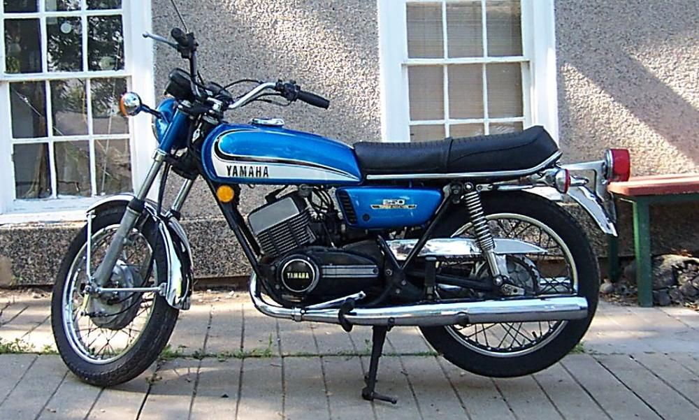 A 1970's era Yamaha 250cc. It's blue. It's agile and small.