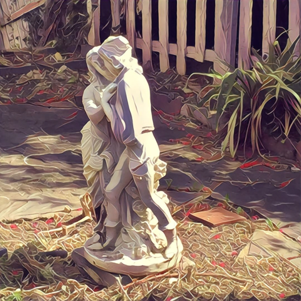 Here is a pic I took of a garden statute in someone's yard as we were taking too long a walk on too hot a morn.
