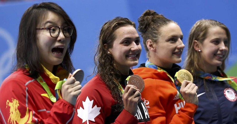 Medalist in the 100m backstroke, Fu Yuanhui (China) Kylie Masse (CAN), gold medalist Katinka Hosszú (Hungary) and (USA) Kathleen Baker.