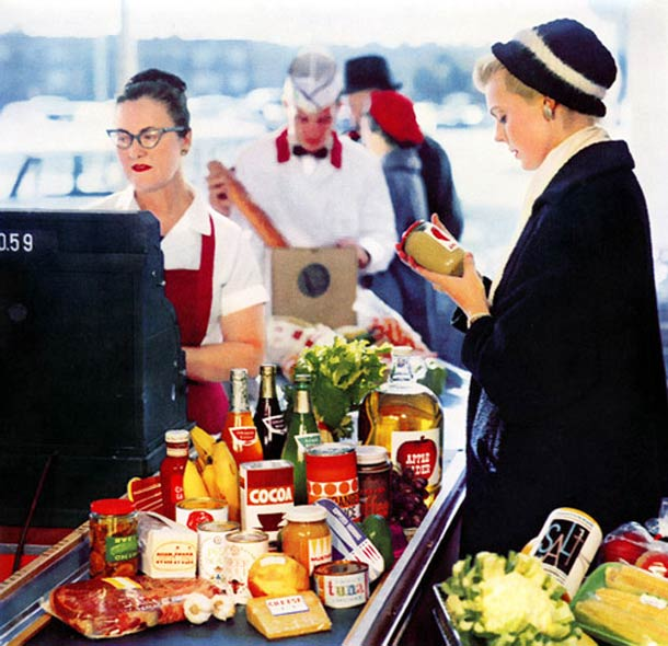 A vintage picture of a well put together woman checking out here groceries. She has a great hat.