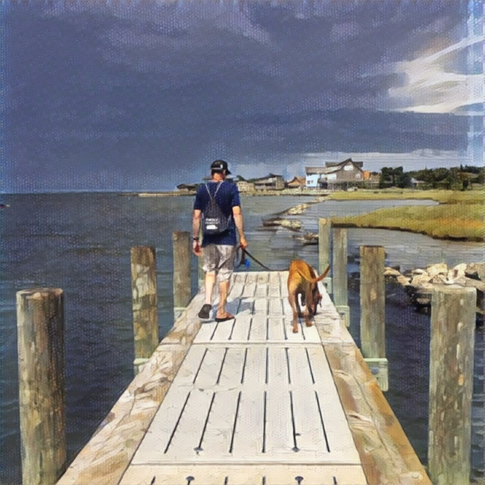 a guy and a dog walking along a dock in Ocracoke.