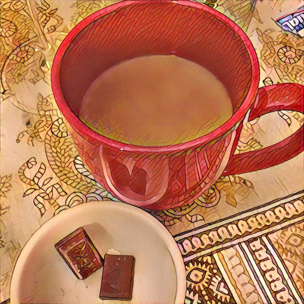 Red mug and little bowl with chocolate.
