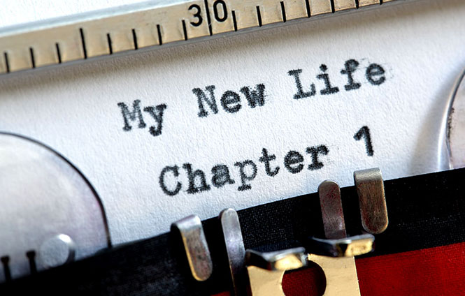 "A typewriter with a paper that has ""My New Life, Chapter 1"" typed on it."