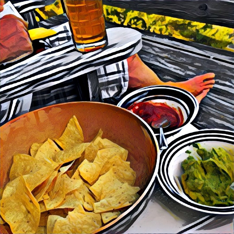 Guac and salsa and chips with a beer on the deck. Looking at the ocean. But you can't see the ocean in this pic.