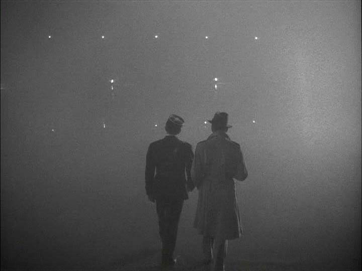 Louis and Rick disappear into the midst, a beginning of a beautiful friendship. Last scene from Casablanca.