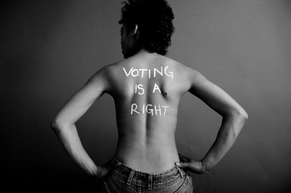 Voting is a right, written on the back of a strong woman
