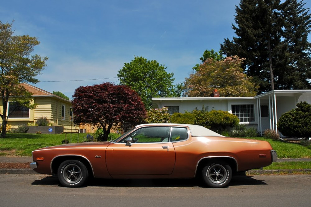 Plymouth Satellite Sebring parked on an idyllic suburban street.