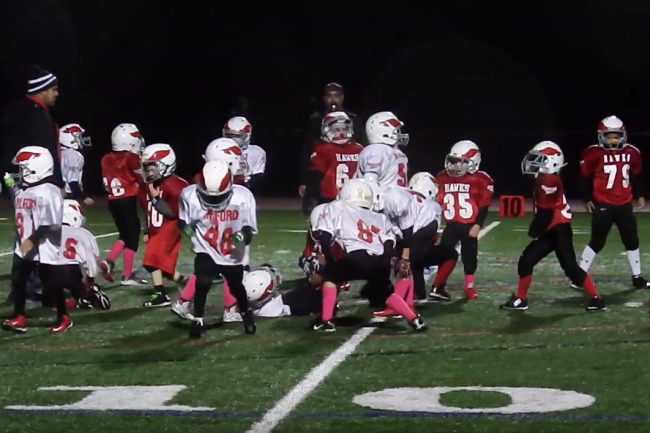 Pee Wee football. It's cute. But even cuter that they stopped to do the nae nae. Dance or tackle?