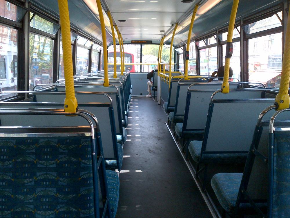 The aisle on an empty bus
