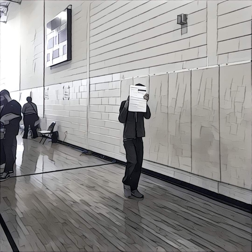 Hiding behind his ballot in the gym.