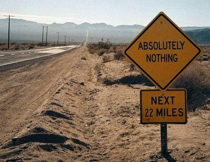 Street sign on a deserted highway that says,