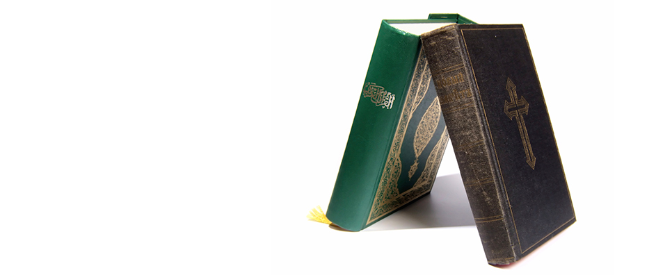 Two books of religious teachings, the Quran and the Bible.