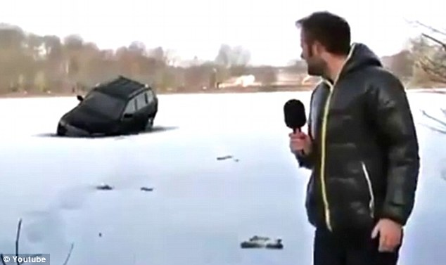 The moment the SUV plunges into the thin ice on the mostly frozen lake. As captured on the local news.