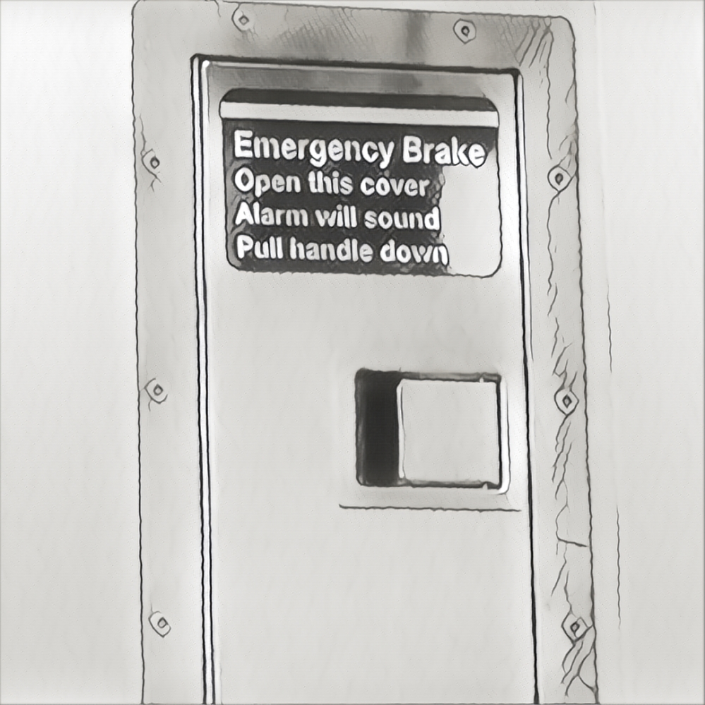 From the AMTRAK: Emergency Brake. Open this cover. Alarm will sound. Pull handle down.
