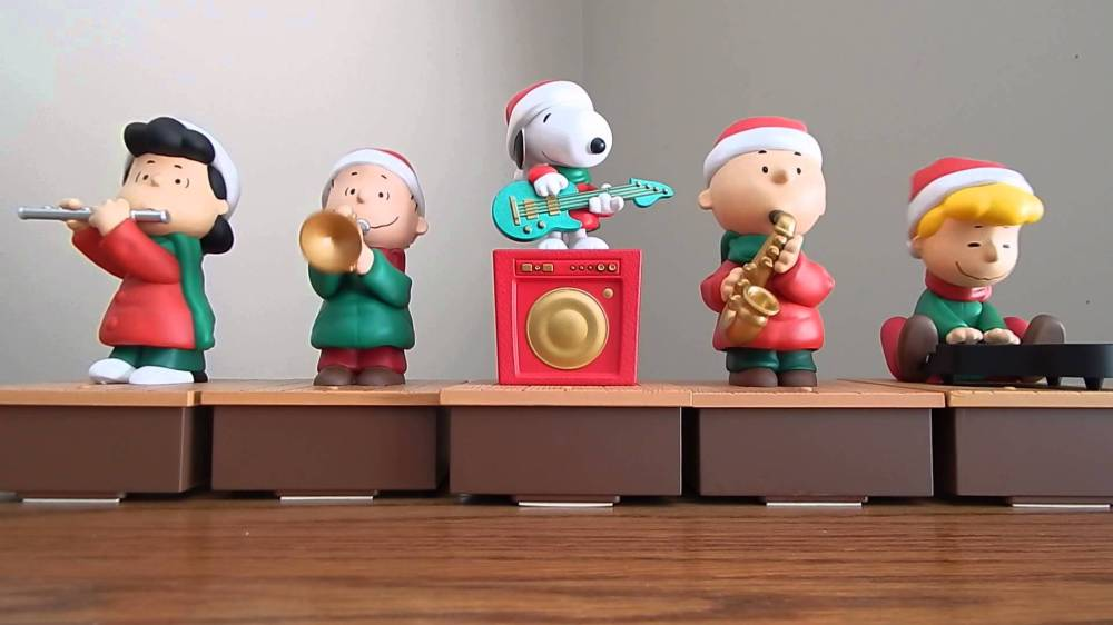 Toy Peanuts band with Lucy on flute, Linus on horn, Snoopy on electric guitar, Charlie Brown on sax and Shroeder on piano, of course.
