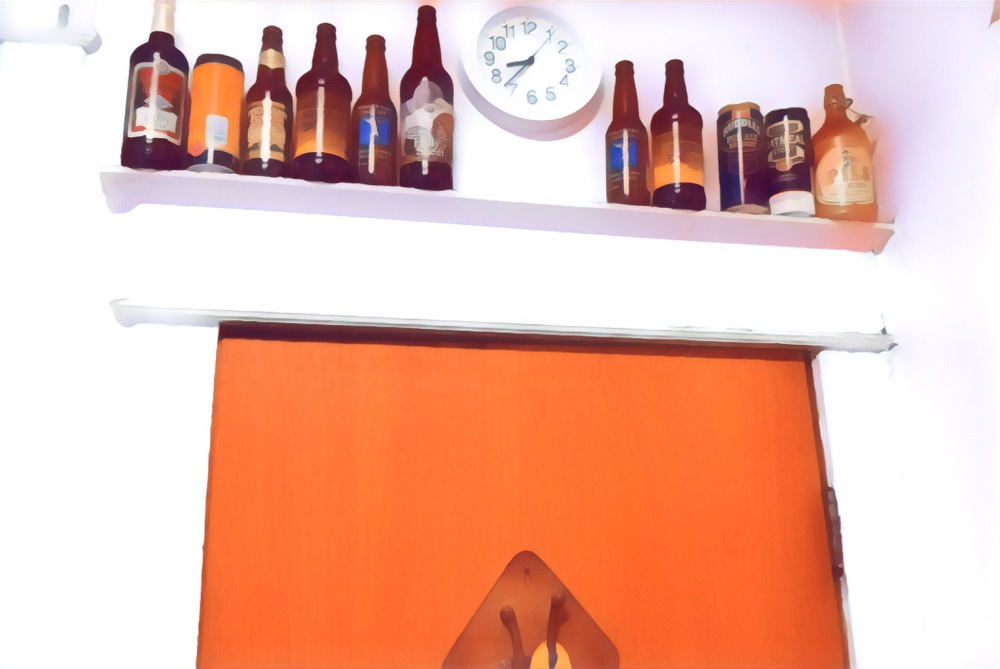 The backdoor, out of the kitchen topped with an odd assortment of empty beer bottles and the kitchen clock.