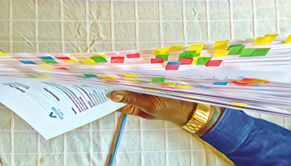 One hundred and seventy eight pages of documents to sign--signatures indicated by colorful sticky flags.
