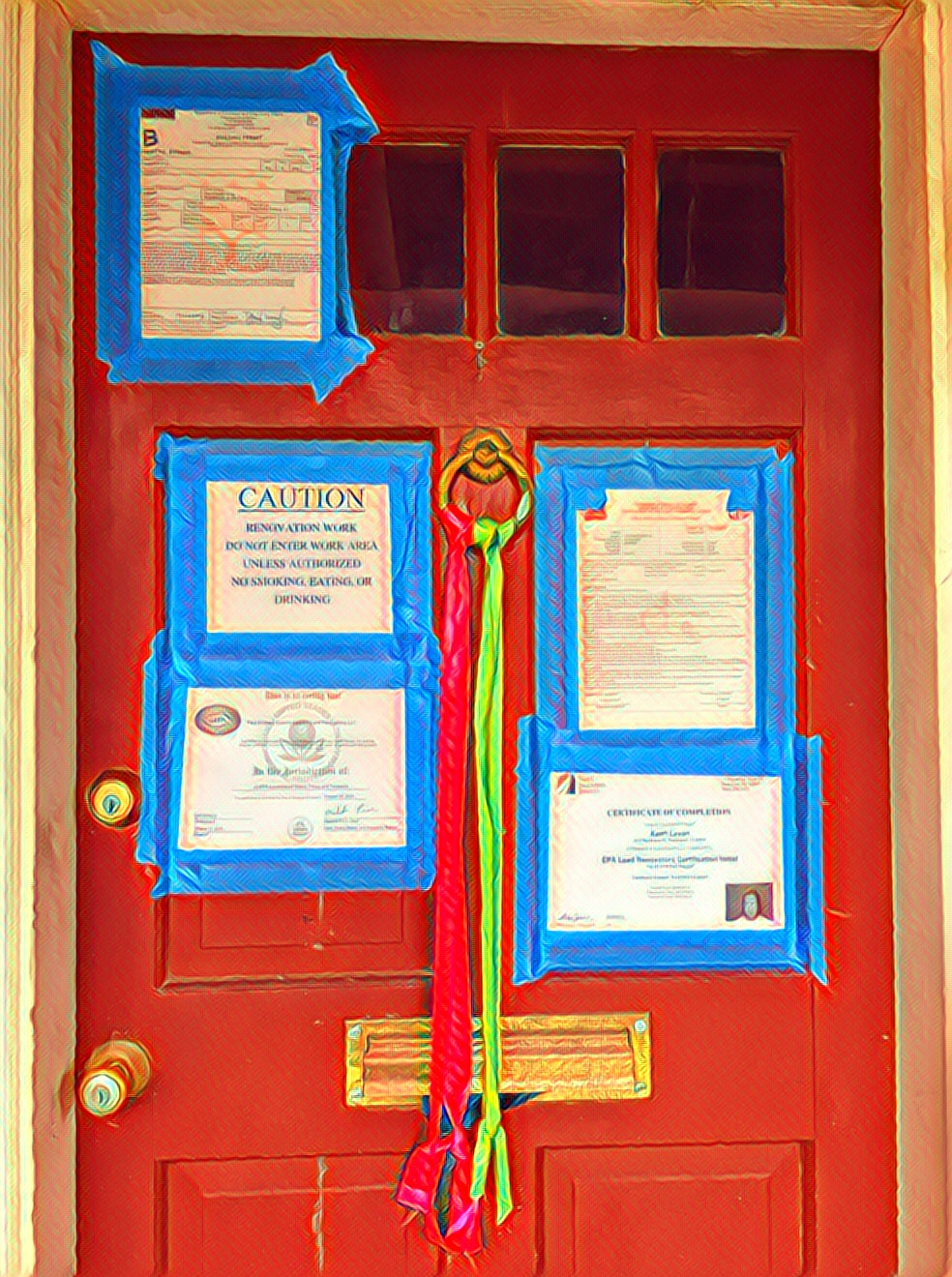 The front door with all the signs of construction.